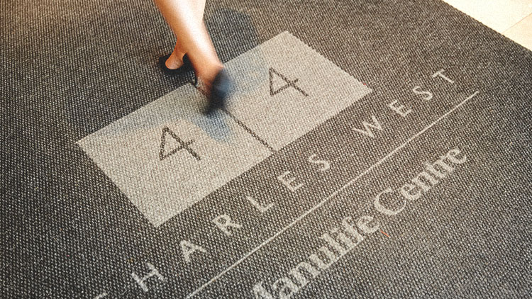 Photograph of the welcome mat at 44 Charles Street West