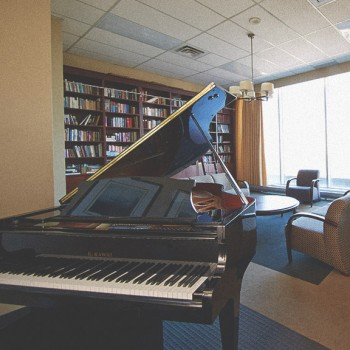 Photograph of the grand piano in the building's library