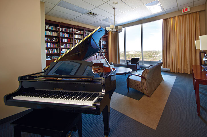 Photo of a piano in a library