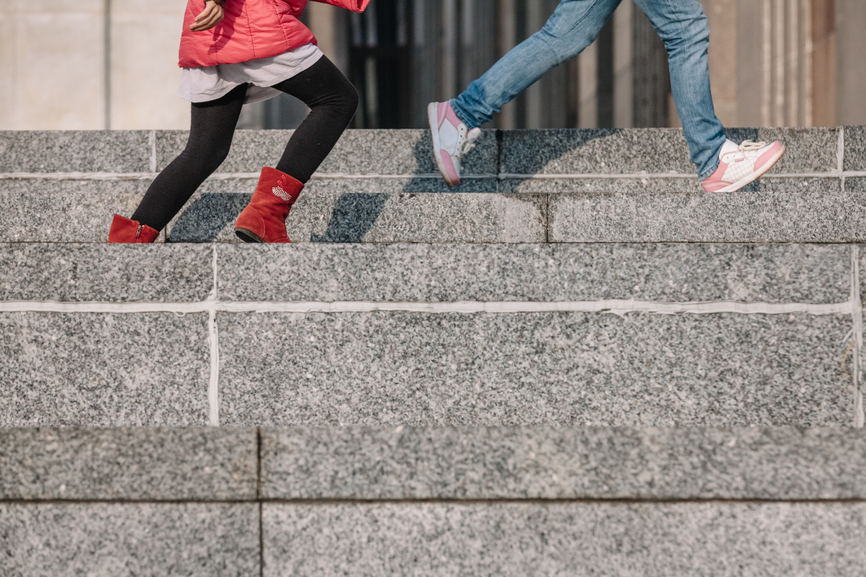 Image of two kids walking up the steps